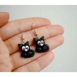 Černé kočičky s růžovým čumáčkem